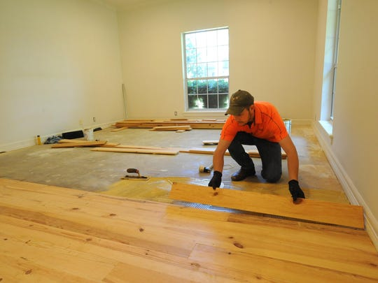 Jared Carter, owner of Carter's Hardwood Floors, lays new hardwood floors at a south Shreveport home.
