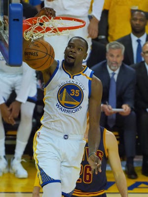 Golden State Warriors forward Kevin Durant (35) dunks against the Cleveland Cavaliers in the first half of the NBA Finals at Oracle Arena.