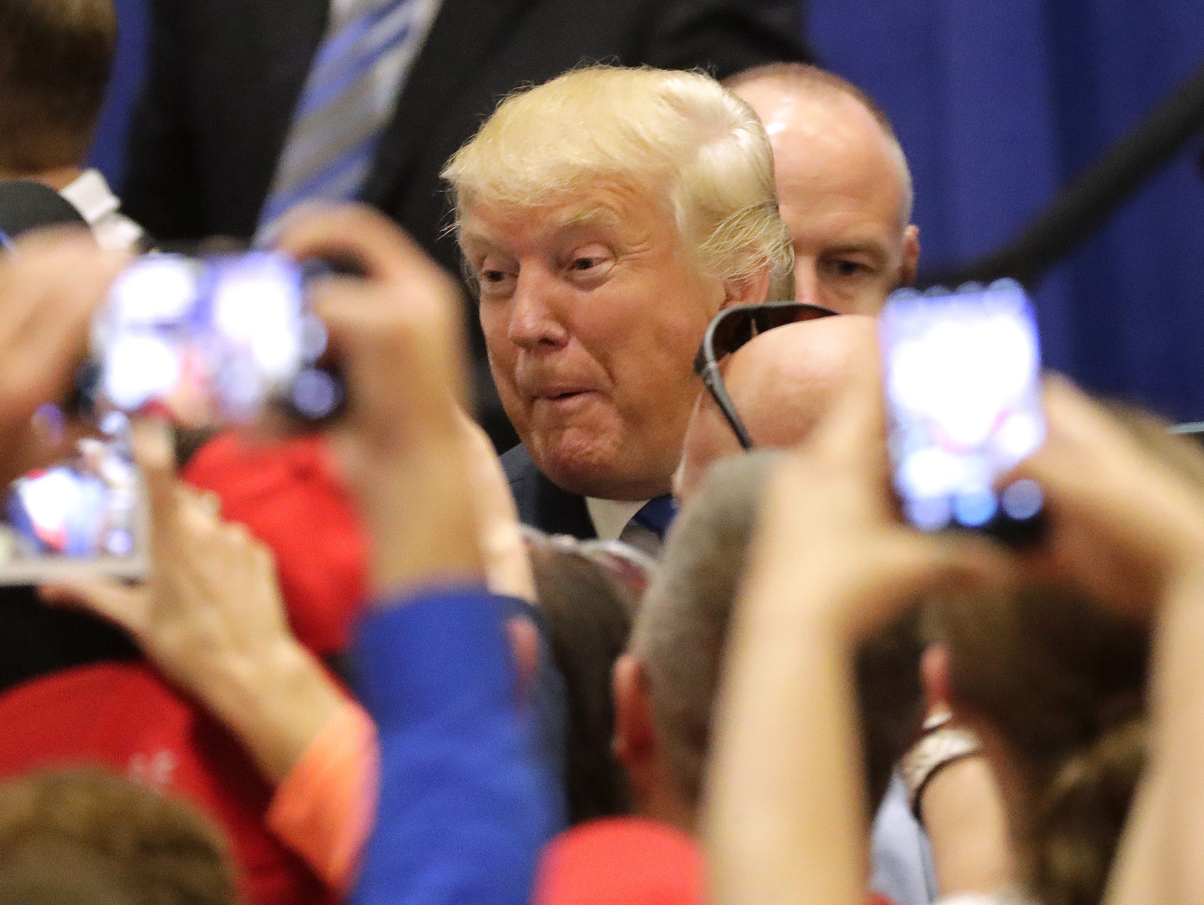 Presidential candidate Donald Trump greets fans after