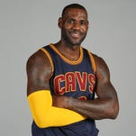 Cleveland Cavaliers star LeBron James poses during 2015 media day in Independence, Ohio.
