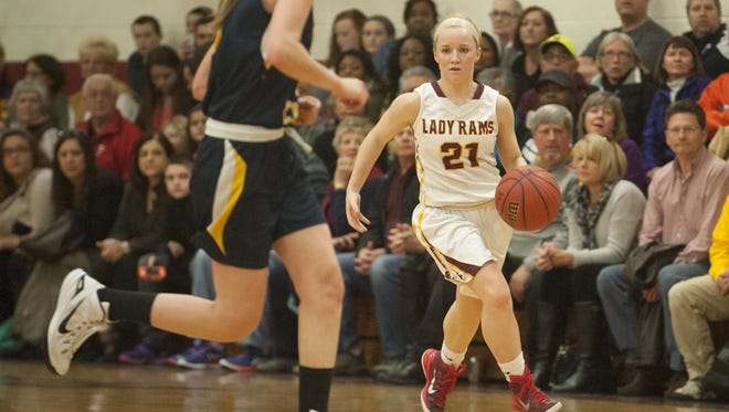 Gloucester Catholic guard Maggie McIntyre dribbles against Gloucester's Jacqueline Myers in a game from last year. McIntyre recently surpassed the 1,000-point mark for her career.