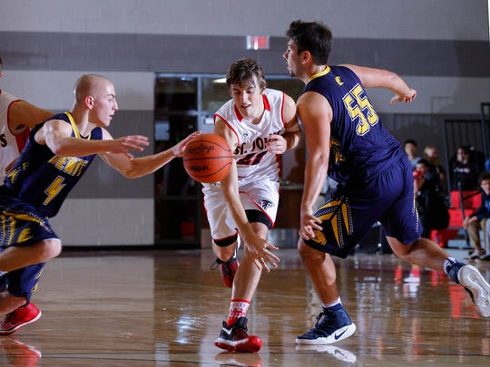 Ben Feldpausch, center, was part of a balanced Redwing roster and helped St. Johns to a 17-win season that included an outright CAAC Red title.