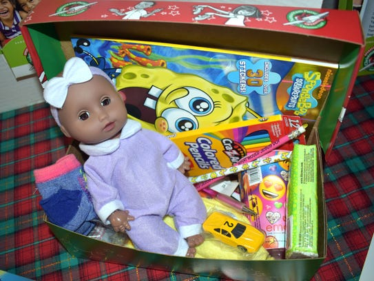Each shoebox is packed with small toys, small clothing items such as socks, school supplies and non-liquid hygiene items.