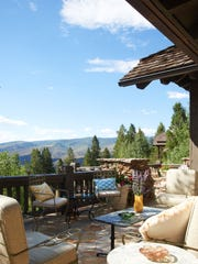 An outdoor living space in a home in Bachelor Gulch, Colorado, decorated by interior designer Jan Showers.