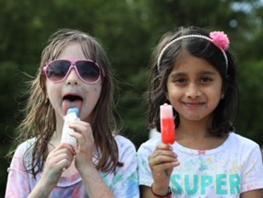 636350516258429628-Sahanna-Rao-and-Anna-Gibbs-enjoying-a-cool-treat..jpeg