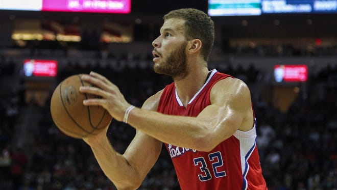 Blake Griffin shoots during the second half at Toyota Center.