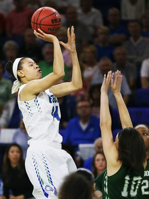 FGCU's Whitney Knight scores against Jacksonville during play Thursday at Alico Arena in Fort Myers. FGCU beat Jacksonville 58-39.