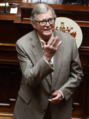 "Author Earl Hamner Jr. blows a kiss to relatives in the gallery as he is honored by the Virginia Senate at the state capitol in Richmond, Va. On Thursday, March 24, 2016, Hamner, who created ""The Waltons"" television show, died in Los Angeles at the age of 92, according to Ray Castro Jr., a friend who produced a documentary about the writer. (AP Photo/Richmond Times-Dispatch, Bob Brown)"