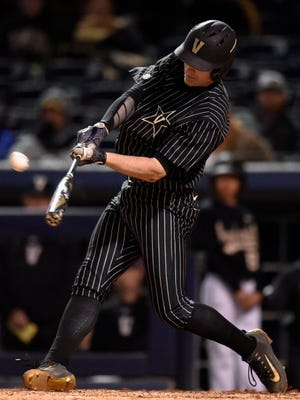 Vanderbilt's Will Toffey connects for a three-run in-the-park home run against Belmont during the fourth inning at First Tennessee Park on March 22, 2017.