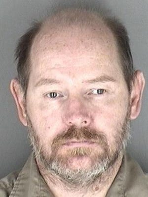 David Leroy Marks Jr., 46, was being held Wednesday in the Shawnee County Jail on an outstanding Shawnee County warrant charging him with a felony sex crime.