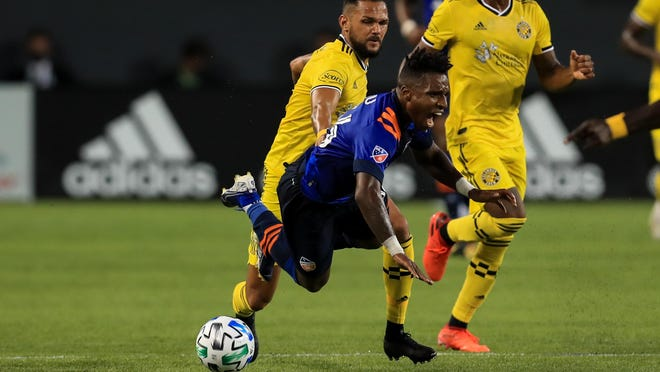 The Crew's Artur tackles FC Cincinnati's Joseph-Claude Gyau during the first half of Saturday night's scoreless tie.