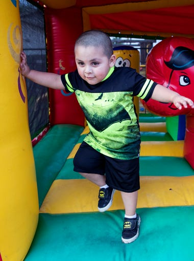Javier Trevino III, 3, plays in a bounce house at the House of Burgers & Wings on Saturday, March  3, 2018. The restaurant features a large play area for children as well as outdoor seating so parents can keep an eye on their kids while they're eating.