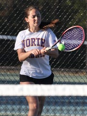 Clarkstown North's Sydney Miller returns a shot during a singles match at the Section 1 girls tennis finals at Harrison Oct. 20, 2017.