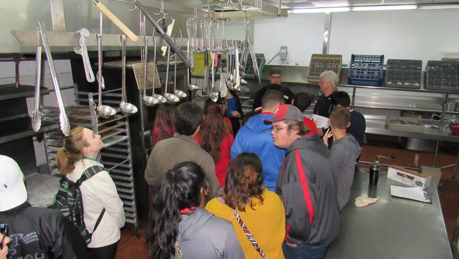 Students from Hammons Educational Leadership Program take a guided tour of the Holiday Inn Airport kitchen during Steven Wheeler's culinary classes.