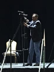 Pascal Enjady prepares the stage for the premiere of