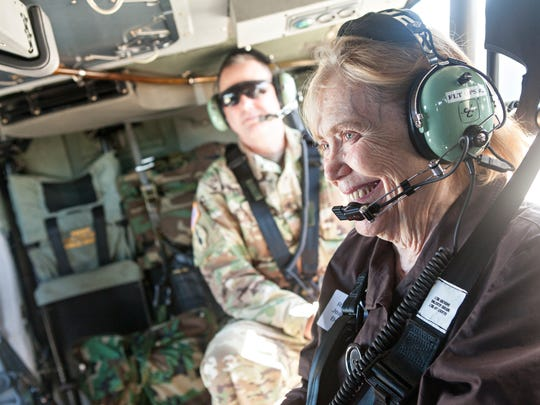 Vermont State Rep. Jean O'Sullivan, D-Burlington, right, and Brig. Gen. Mark Lovejoy, director of joint staff for the Vermont National Guard, ride on a Black Hawk helicopter from Burlington to Fort Drum, N.Y., on Thursday, June 15, 2017, to observe soldiers as they take part in annual training.