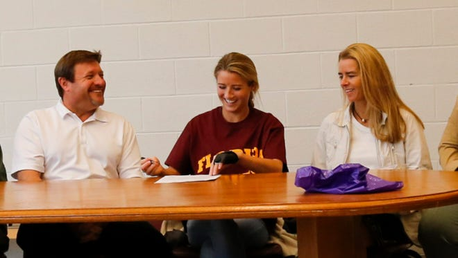 Ayla Bonniwell, flanked by parents Tim and Lisa, signs a letter of intent to Florida State University, which she will attend on a diving scholarship.