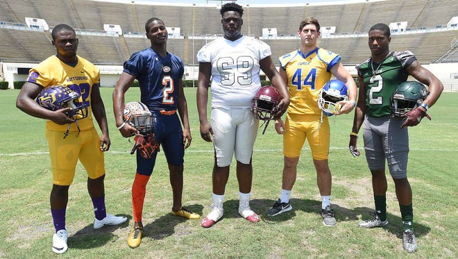 Mississippi State commits (from left) Fabian Franklin, Hattiesburg running back, Malik Heath, Callaway wide receiver, Kwatrivious Johnson, Greenwood tackle, Jett Johnson, Tupelo linebacker, and Marcus Murphy, West Point athlete, pose for pictures at the Dandy Dozen photo day at Mississippi Veterans Memorial Stadium in Jackson on July 26, 2017.