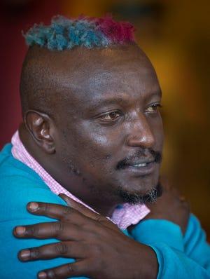 Prize-winning Kenyan author Binyavanga Wainaina talks during a television interview in Nairobi, Kenya, on Jan. 22.