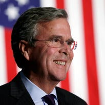 Republican presidential candidate former Florida Gov. Jeb Bush reacts to a supporter during the Scott County Republican Party's Ronald Reagan Dinner, Tuesday, Oct. 6, 2015, in Davenport, Iowa. (AP Photo/Charlie Neibergall)