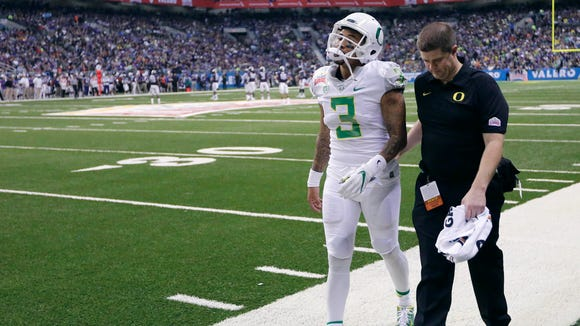 Jan 2, 2016; San Antonio, TX, USA; Oregon Ducks quarterback Vernon Adams, Jr. (3) is helped off the field after a hit against the TCU Horned Frogs in the 2016 Alamo Bowl at the Alamodome. Adams was taken out of the game. Mandatory Credit: Erich Schlegel-USA TODAY Sports