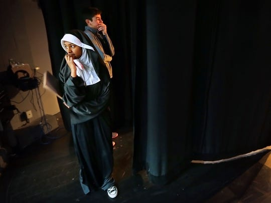 Isabell Kagoo (left) and Jad Hamze from Lausanne Collegiate School wait for their chance on stage to perform a short history skit about Galileo Galilei during the West Tennessee Regional History Competition at the University of Memphis.