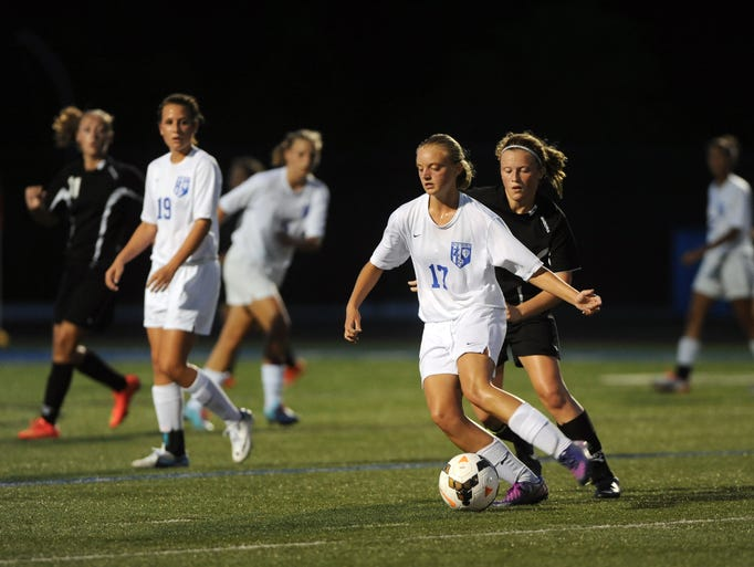 Zanesville's Allie Murphy turns the ball in front of River View's Mallory Griffin Tuesday night in Zanesville.
