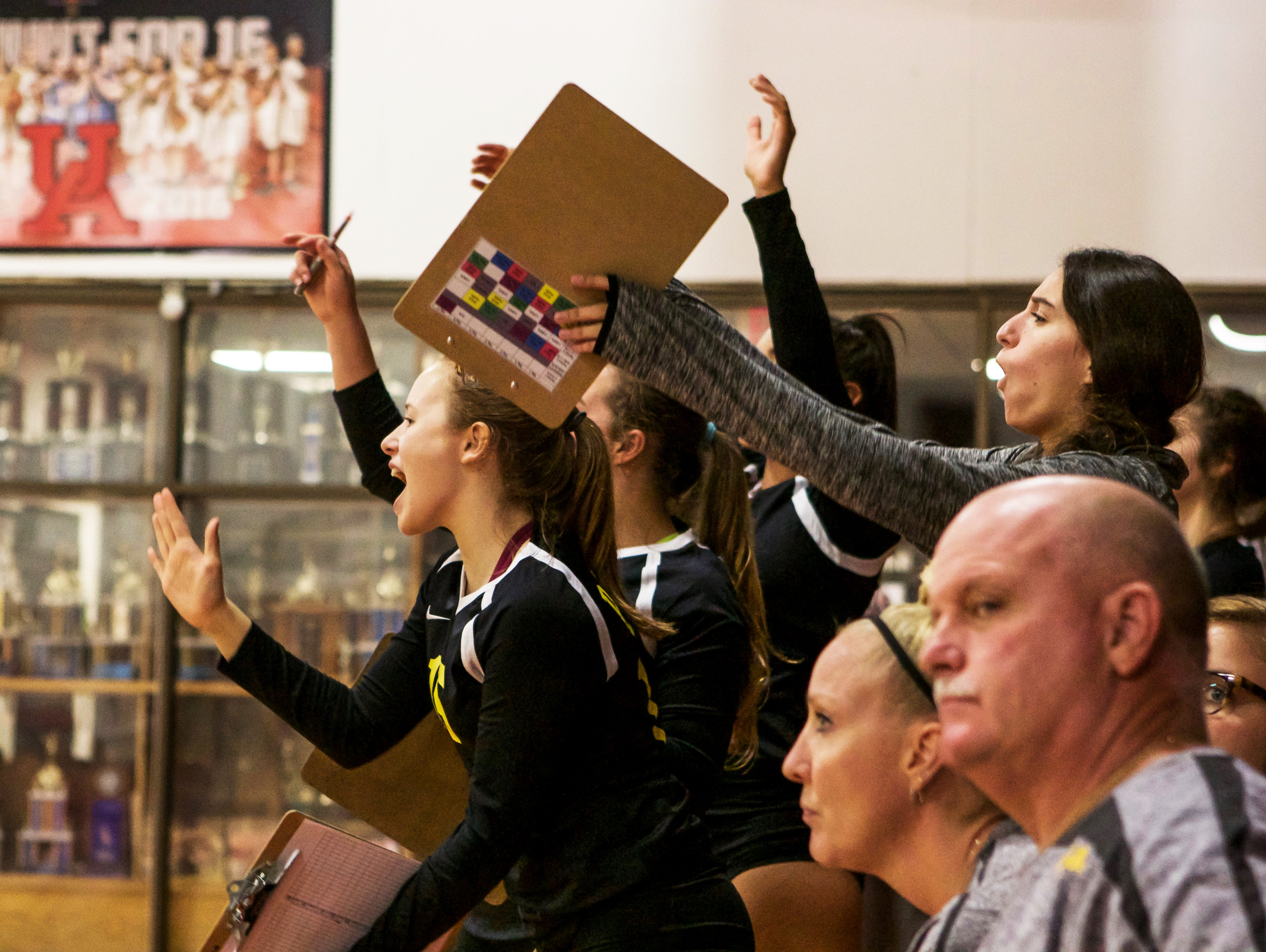 On the sideline, Padua players cheer on their teammates.