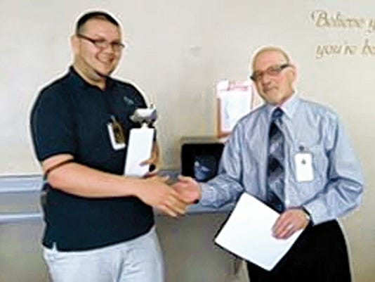 Daniel Molina, left, is given his award by Mesilla Valley Hospital CEO Bob Mansfield. (Courtesy photo)