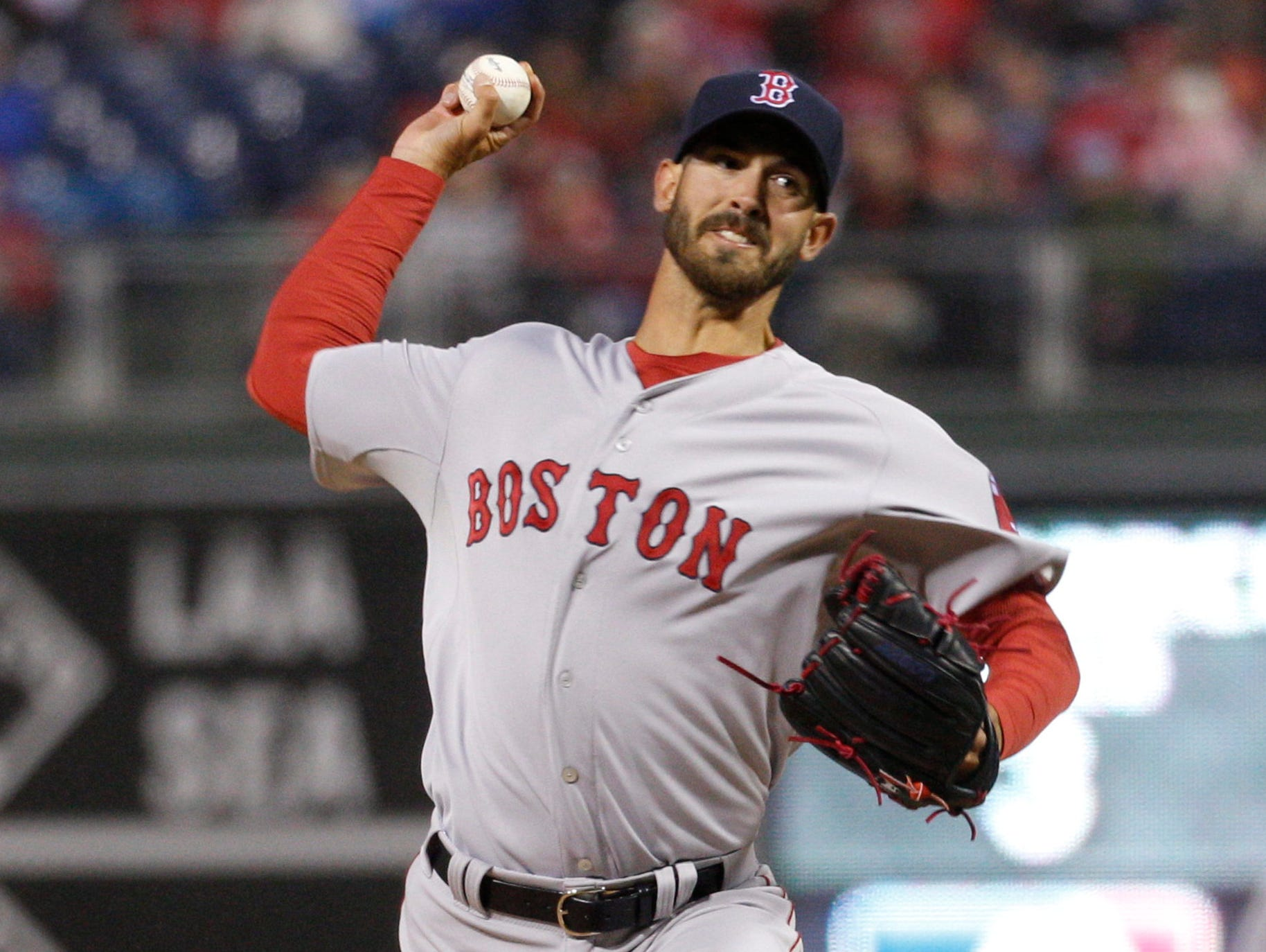 Rick Porcello throws a pitch during the second inning of his Red Sox debut against Philadelphia.