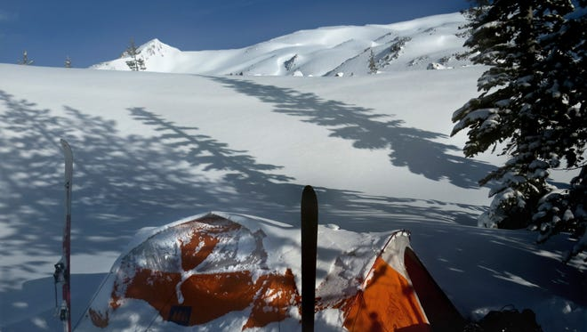 Our ski camp tent is covered by snow on the second morning.
