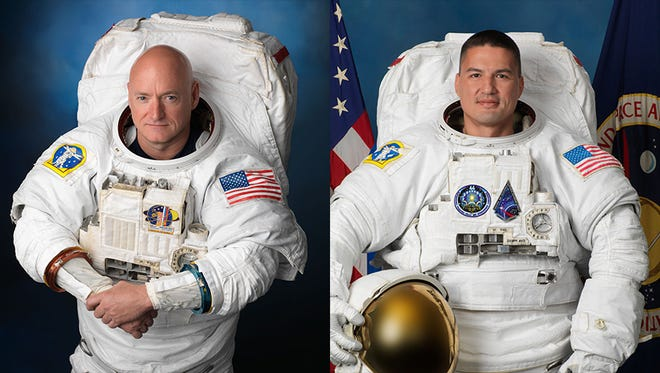 Portrait of NASA astronauts Scott Kelly, left, and Kjell Lindgren in spacewalking suits.