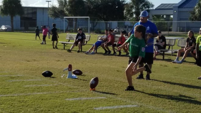 Kira Meacham lines up to punt a football at the 2016 Punt, Pass & Kick on Saturday, Oct. 15, 2016, at Cabaniss Soccer Field.