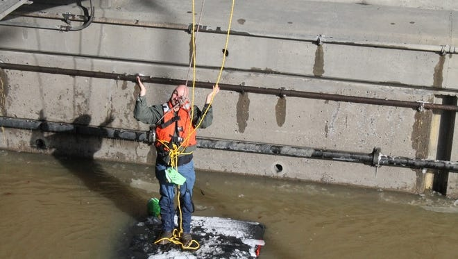 """Jason Corbin of Irwin shrugs his shoulders after being rescued from flood waters on The Parkway in Pittsburgh. He later told the Pittsburgh Post-Gazette, """"I need the Steelers to win tomorrow because of my stupidity."""""""