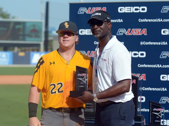 Southern Miss player Taylor Braley is given an award during the Conference USA Championship game against Rice at MGM Park in Biloxi on Sunday.