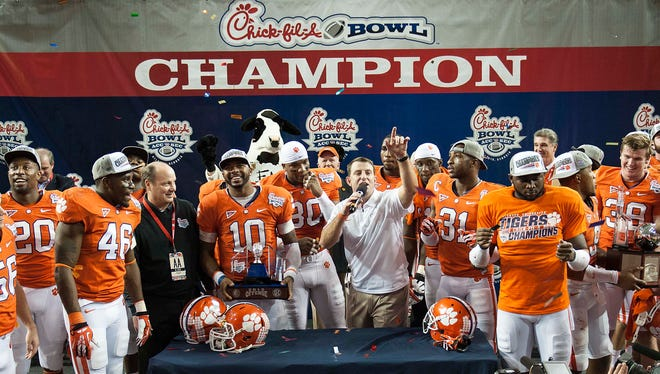 Clemson Tigers head coach Dabo Swinney speaks to the crowd as his team celebrates after defeating the LSU Tigers during the 2012 Chick-fil-A Bowl at the Georgia Dome.