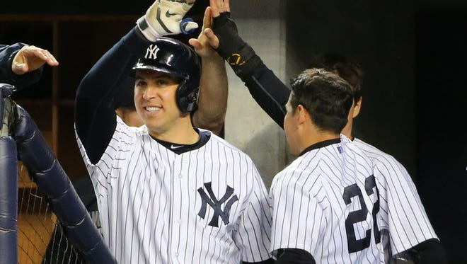 New York Yankees center fielder Jacoby Ellsbury celebrates scoring during the eighth inning against the Los Angeles Angels at Yankee Stadium.