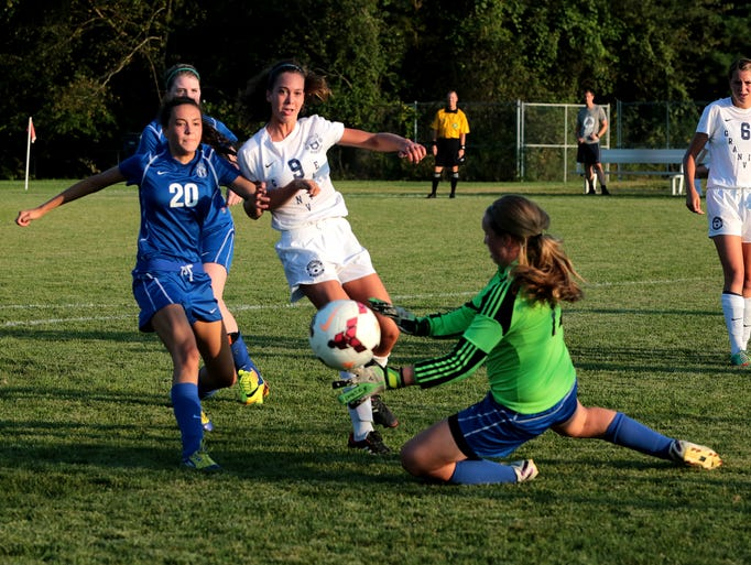 Reilly Welles scores the 4th goal in the first half of a game against Bishop Ready. Granville hosted Bishop Ready Monday night winning their second game of the season 11-2.