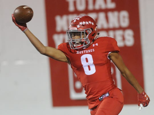 Sweetwater receiver Kobe Clark celebrates after catching a 31-yard touchdown pass from Chris Thompson to help the Mustangs take a 21-13 lead over Seminole with 11:44 left in regulation. Seminole won the District 2-4A Division II game 28-27 in overtime Oct. 27, 2017, at the Mustang Bowl in Sweetwater.