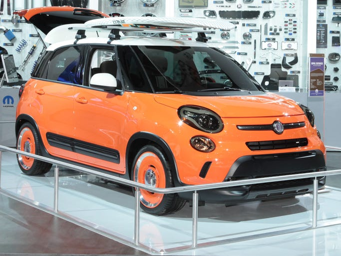 """The Fiat 500L Thalassa in the Mopar display at the 2014 Detroit Auto Show. The """"Dreamsicle on wheels"""" is done up with Mopar parts into a very cool road trip car."""