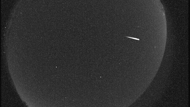 In this image provided by the Tellus Science Museum, a Quandrantid meteor passes over Cartersville, Ga., at 5:30 a.m., EST., Wednesday, Jan. 4, 2011,.