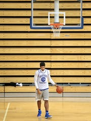 Shortridge's Various Wilson, a 6-foot-5 senior center, warms up by himself before the start of practice, Dec. 18, 2014.