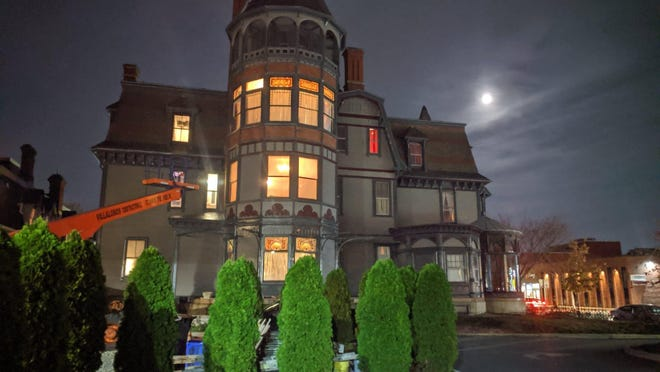 """Kaitlyn Frolich decorates the exterior of Barnaby Castle in Providence in preparation to shoot """"Tales From The Castle,"""" a film that will be screened this year in lieu of the annual Halloween bash that is held at the Victorian house on Broadway. The party was canceled this year because of the coronavirus."""