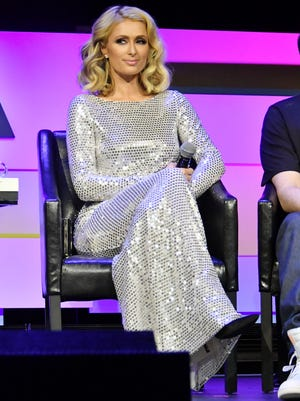 "Paris Hilton speaks onstage at the screening of ""The American Meme"" during the Tribeca Film Festival in New York Friday."