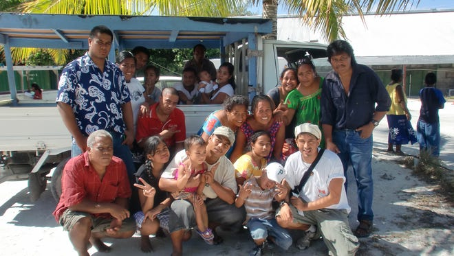 Mike Roman, bottom right, with his Kiribati host family in 2012.