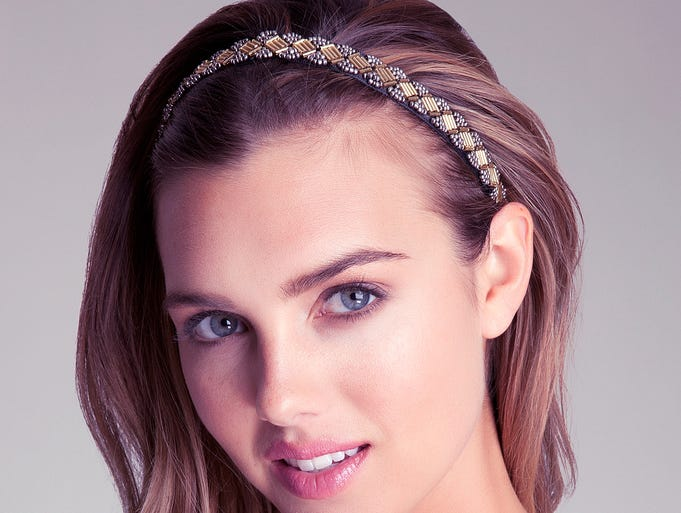 """<p>When it comes to figure skating fashion, more is not remotely enough. """"It would be boring if everyone had the same outfit on,"""" says Tara Lipinski, the NBC commentator who won a gold medal at the 1998 Winter Olympics. To give your own hair some sparkle, try this mixed-metal creation by Bebe. $22 at Bebe.com</p>"""