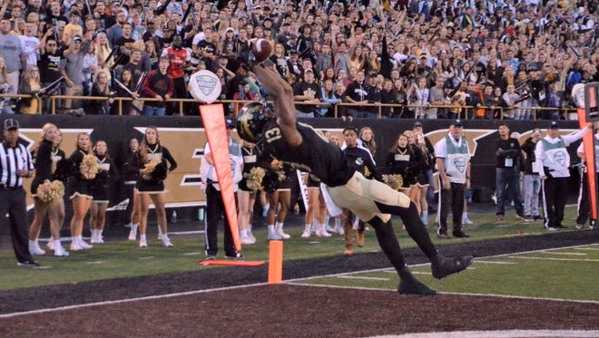 Western Michigan receiver Keishawn Watson catches a 12-yard touchdown pass in the first quarter of a game against Ball State on Saturday at Waldo Stadium in Kalamazoo.