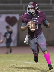 Mt. Whitney quarterback Jaedyn Pineda rolls out against