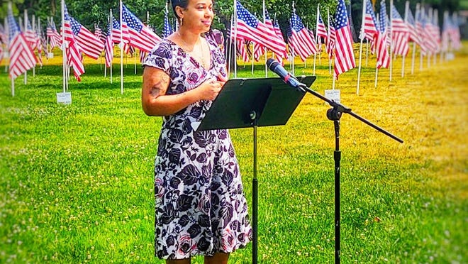 """Mayara Reis of North Andover, co-founder of the Merrimack Valley Black and Brown Voices and Allies, reads from Frederick Douglass's """"What to a Slave is the Fourth of July?"""" at North Andover Town Common for a video presentation to the town."""