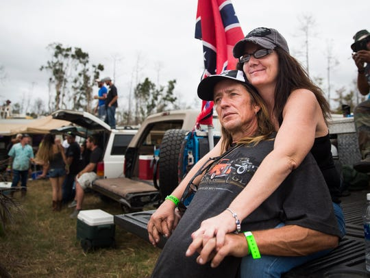 Julia Murphy and Billy Kronz watch the races from the bed of a pickup truck during the Swamp Buggy Races Winter Classic on Sunday at the Florida Sports Park.